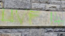 Sectarian and racist graffiti on the Catholic church in Dungannon, Co Tyrone, is removed by a parishioner