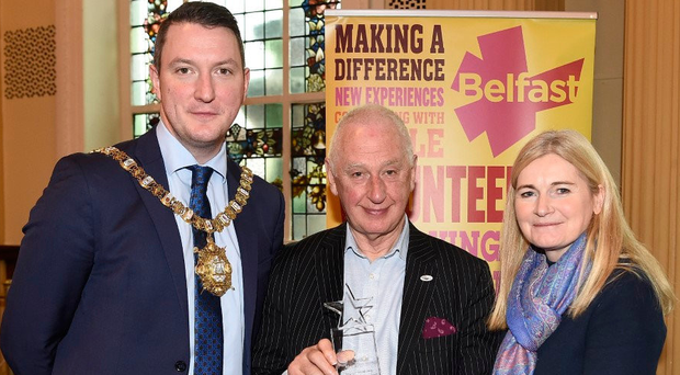 Lord Mayor John Finucane and Siobhan Toland of Belfast City Council with Colin Flinn, winner of the Marie Mathews Participation Award at this year's Age-friendly Older Volunteer of the Year Awards at Belfast City Hall