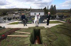 Father Gerard Alwill performing the final committal over Anne's coffin at the burial