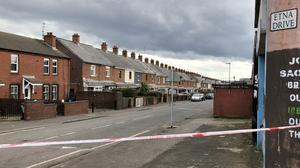 The scene at Etna Drive in the Ardoyne area of Belfast, where a man has died following a shooting (David Young/PA)