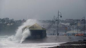 Storms: Waves crash against the beach at Tramore in Co Waterford, where a warning is in place for 100kph winds