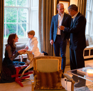 George talks to his mum while sitting on his rocking horse in Kensington Palace