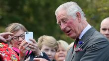 The Prince of Wales meets well-wishers outside the Eglinton Community Centre
