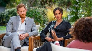 Harry and Meghan are interviewed by Oprah Winfrey. (Photo by Harpo Productions/Joe Pugliese via Getty Images)