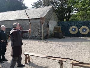 An archer takes aim at Castle Ward -  the Stark family's home, Winterfell