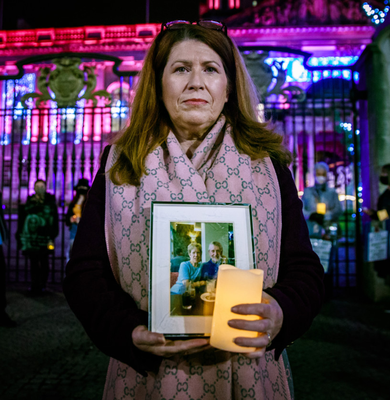 Agony: Cathy Austin holds a photo of her mother and father - Kathleen and Martin Hill