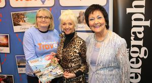Debbie McGee visits the Belfast Telegraph stand. From left, Joanne Uprichard, Marketing Manager and Maureen Ledwith, Holiday World Show Sales Director