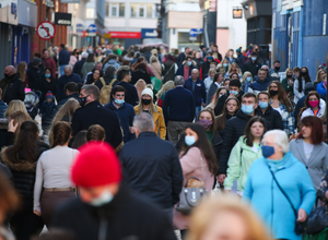 In a rush: Shoppers throng the streets of Belfast city centre yesterday afternoon