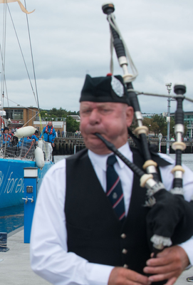 A piper welcomes the arrivals