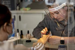 Paige Hegarty (left) having her nails done at Hollywood Nail Salon in Belfast by nail manicurist Rebecca Clarke, as lockdown restrictions ease allowing nail salons to reopen. PA Photo. Picture date: Monday July 06, 2020. See PA story ULSTER Coronavirus. Photo credit should read: Liam McBurney/PA Wire