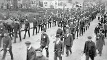 Into the unknown: Rifleman Jackson Clarke (circled) marching off to war