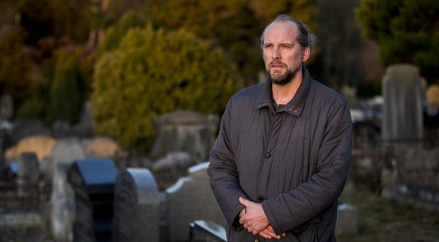 Peter McCabe has taken a year to compile his book on Dundonald cemetery (Liam McBurney/PA)