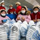 Workers producing facemasks at factory in Handan in China's Hebei province