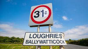 Amended road sign at Ballywatticock in Co Down where a new high of 31.2 degrees was recorded. Credit: Kevin Scott / Belfast Telegraph