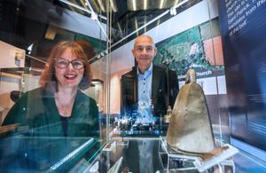 Stella Byrne, casework manager from the Heritage Lottery Fund, and Dr Greer Ramsey, curator of archaeology at National Museums NI, and the bronze bell on display at the Ulster Museum
