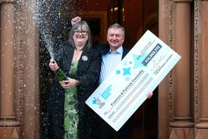 Frances celebrating their £115m Lottery win with husband Patrick in 2019