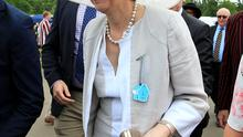Home Secretary Theresa May sporting a colourful hat as she relaxed yesterday at Henley Royal Regatta