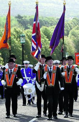 Orange Order parade...Orange Order members arrive at Stormont in Belfast, during a massive loyal order parade to mark the centenary of the signing of the pro-Union Ulster Covenant. PRESS ASSOCIATION Photo. Picture date: Saturday September 29, 2012. An estimated 30,000 marchers will take part in the Orange Order event which will see a huge cultural festival staged in the grounds of the Northern Ireland Assembly at Stormont in east Belfast, held to commemorate the 1912 proclamation against plans for Home Rule in Ireland. See PA story ULSTER Parade. Photo credit should read: Paul Faith/PA Wire...A