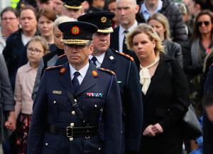 Garda Commissioner Drew Harris walks behind the coffin of Detective Garda Colm Horkan