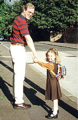 Treasured: Ciaran Shannon walking his daughter Niamh (25) to school over the years