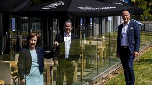 From left, Northern Ireland Economy Minister Diane Dodds alongside restaurant owner Michael Deane and Colin Neill of Hospitality Ulster (Liam McBurney/PA)