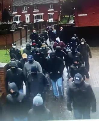Sinister : A group of masked men walk around the Pitt Park area of east Belfast