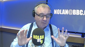 Hands up: Eamonn Holmes filling in for Stephen Nolan on his radio show on Monday