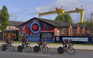 Cyclists pass the mural during a time trial for last year's Giro d'Italia