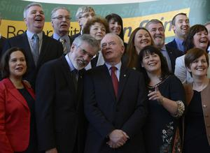 Martin McGuinness and Gerry Adams share a joke as Sinn Fein unveils its Assembly candidates at the Mac in Belfast yesterday