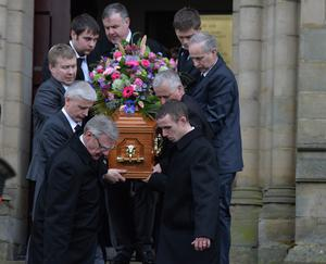 Family members carry Lesley-Ann's coffin