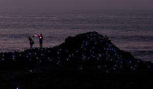 Rosie Fairburn-Clarke and her friend Grace Higgins during a visit to the Giant's Causeway to see its famous features bathed in light in celebration of Unesco's International Year