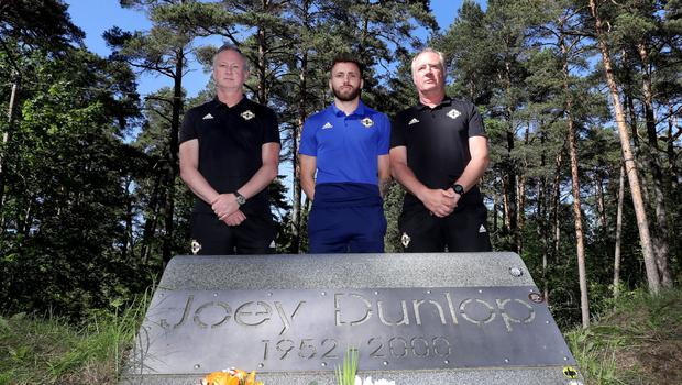 NI manager Michael O'Neill, assistant manager Jimmy Nicholl and winger Stuart Dallas visit the memorial to Joey Dunlop near Tallinn in Estonia