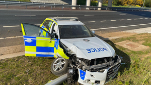 A police officer was taken to hospital after a car rammed a patrol vehicle (PSNI Road Policing and Safety/PA)