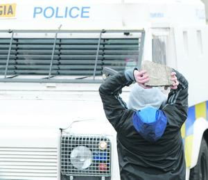 1/4/2013 PACEMAKER BELFAST. Nationalist youths react to PSNI officers near the 32 County Sovereignty Easter rising commemoration parade in the Creggan estate, Derry this afternoon. Picture Charles McQuillan/Pacemaker.