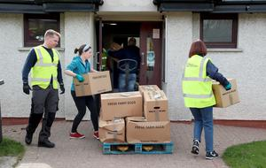 Antrim and Newtownabbey Borough Council workers prepare and deliver some of the 10,000 food boxes being delivered to the most vulnerable in society throughout Northern Ireland