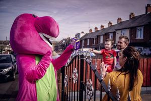 Paul McCusker and community workers dressed as characters deliver Easter eggs to children in the Ardoyne area of north Belfast