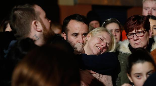 Eoin's mum Lisa Hamill is comforted