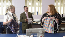 Inspiring: Justice Minister Naomi Long with Magilligan Prison governor Richard Taylor and senior officer Wendy Graham in the Sewing Bee Hub at Magilligan Prison