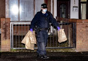 Police search a nearby house last night