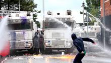 Sporadic violence erupts in north Belfast after police stop the anti-internment parade from entering the city centre