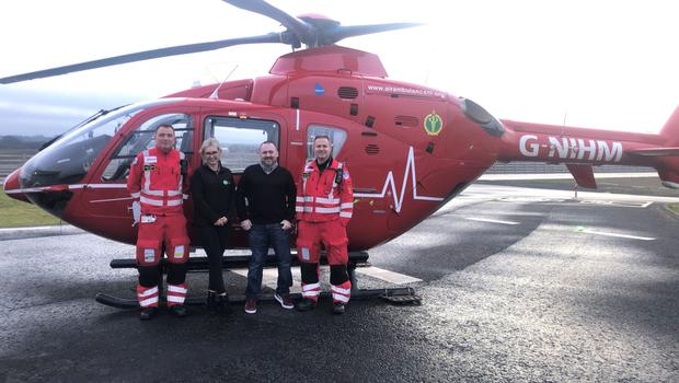 At the Air Ambulance Northern Ireland base in Lisburn are (from left) paramedic Phil Hay, Erin Kelly, her dad, road crash survivor Peter, and Dr Campbell Brown