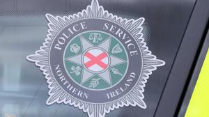 A stock picture of a Police Service of Northern Ireland (PSNI) logo badge in Belfast Northern Ireland (Niall Carson/PA)