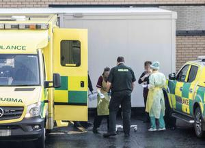 A patient arrives at Antrim Area Hospital to be assessed for coronavirus yesterday afternoon