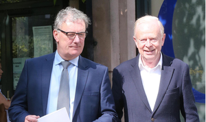 Mike Nesbitt and Sir Reg Empey leave the Electoral Office in Belfast yesterday