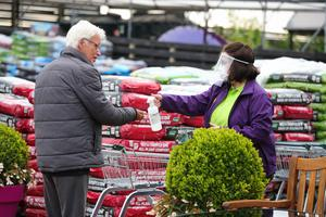 A shopper and a member of staff at Hillmount Garden Centre in Belfast yesterday