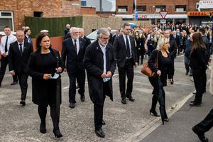 Controversy: Mary Lou McDonald, Gerry Adams, and Michelle O'Neill arrive at St Agnes' Church in west Belfast for the funeral of Bobby Storey in June