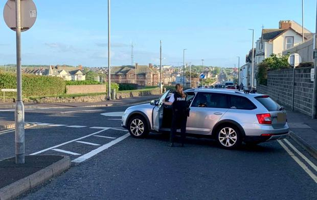 Police close roads into Portrush on Sunday evening after an influx of visitors to the town. Pic McAuley Multimedia