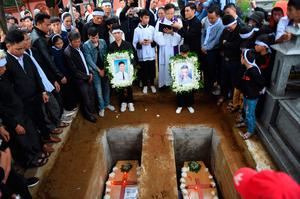 Cousins Nguyen Van Hung (left) and Hoang Van Tiep are laid to rest