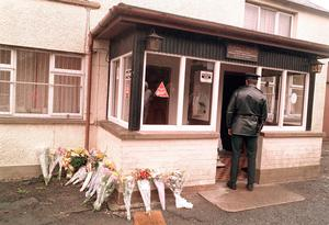 Floral tributes outside the Heights Bar after the UVF massacre in 1994