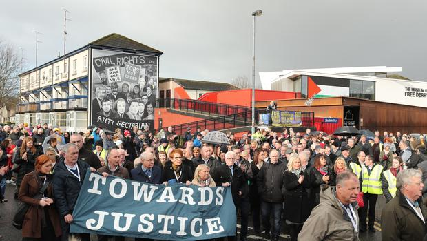 Families march through the Bogside in Londonderry (Niall Carson/PA)